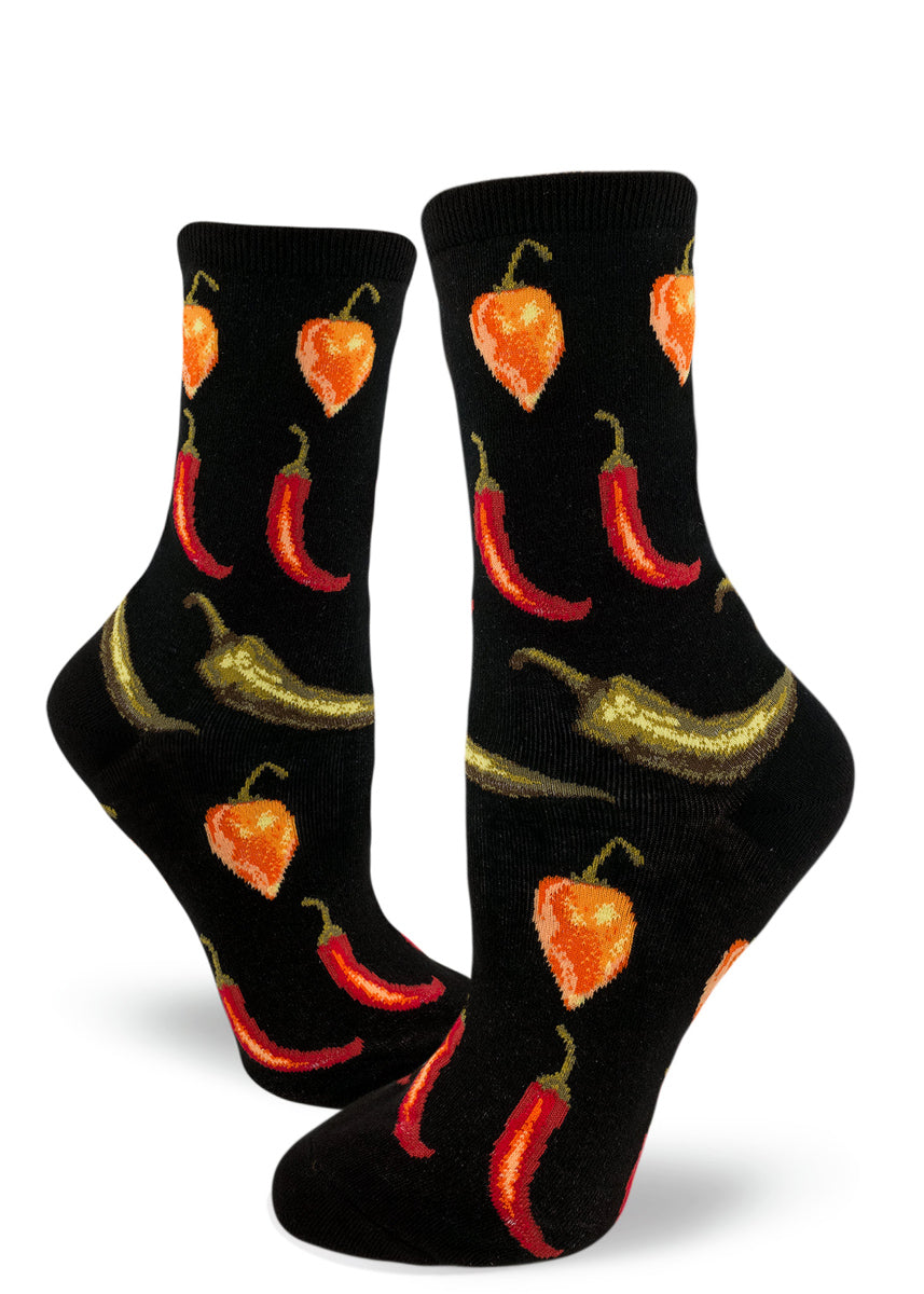 Women's chili pepper socks with orange habaneros, red cayenne peppers and green jalapeños on a black background