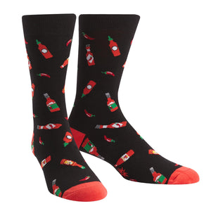 "Hot sauce bottles and spicy chilis on men's socks gives a new definition to the phrase ""hot foot""!"