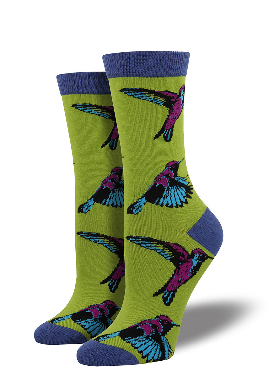 Hummingbirds fly on these green bamboo socks for women.