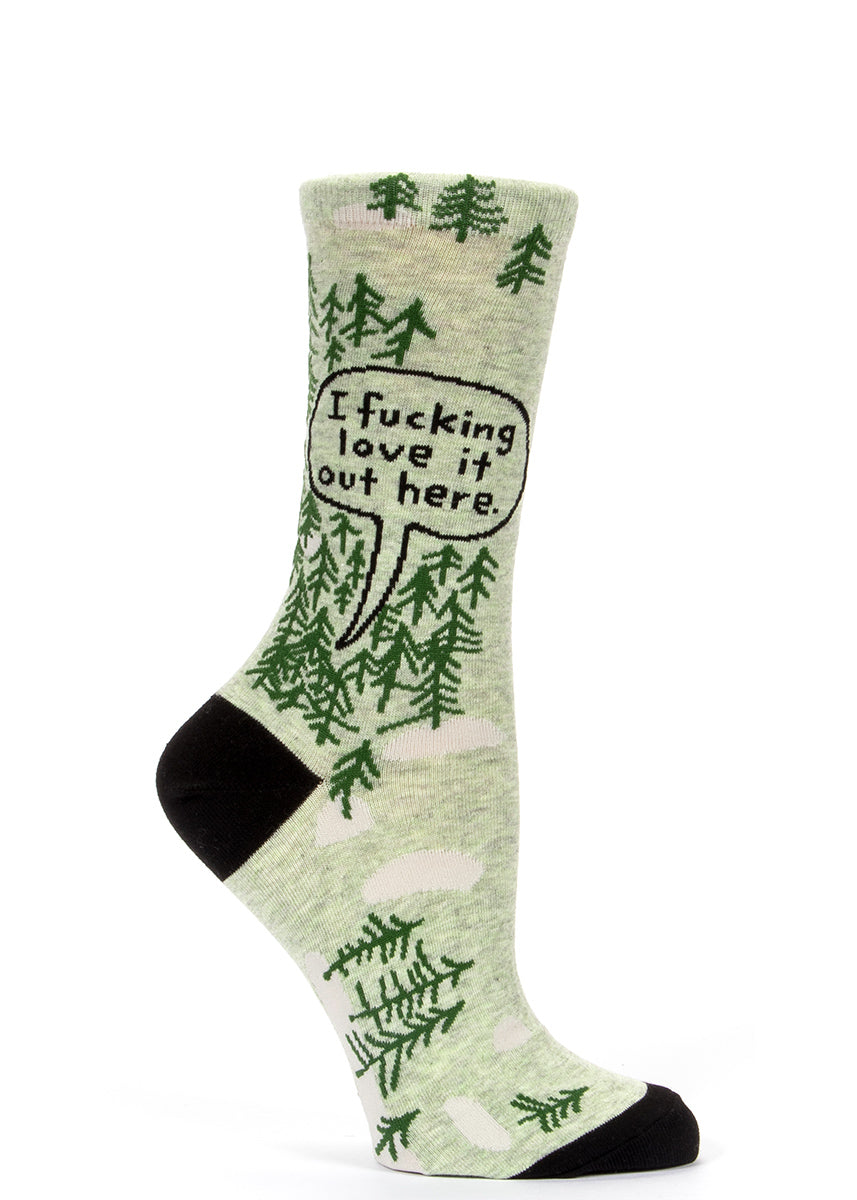 "Women's socks with trees and a speech bubble that says ""I fucking love it out here."""