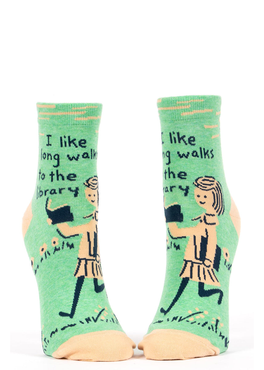 "Ankle socks for women show a girl reading with the words, ""I like long walks to the library."""