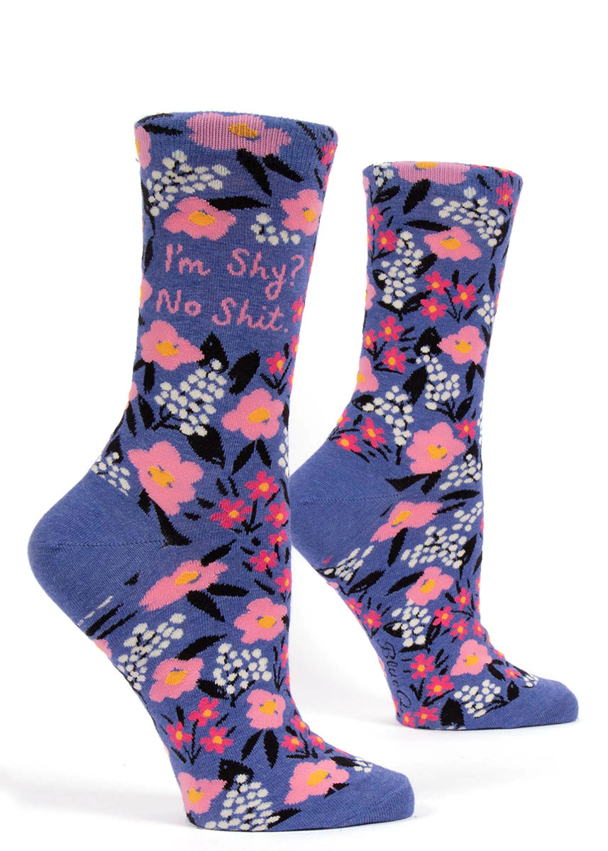 "Introvert socks for women that say ""I'm Shy? No shit."" on a pink and blue floral background"
