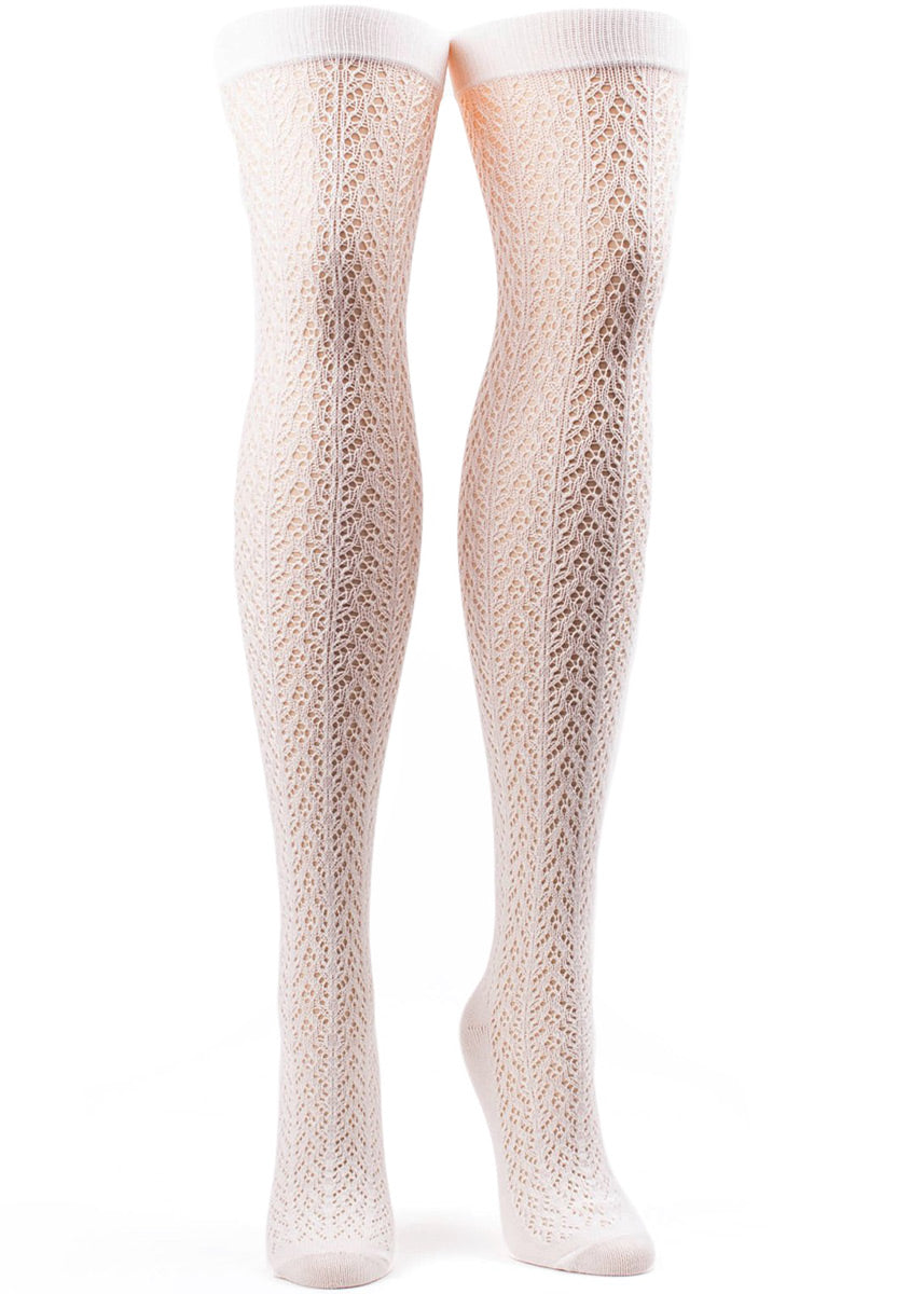 Ivory over-the-knee socks for women with an open crocheted pattern.