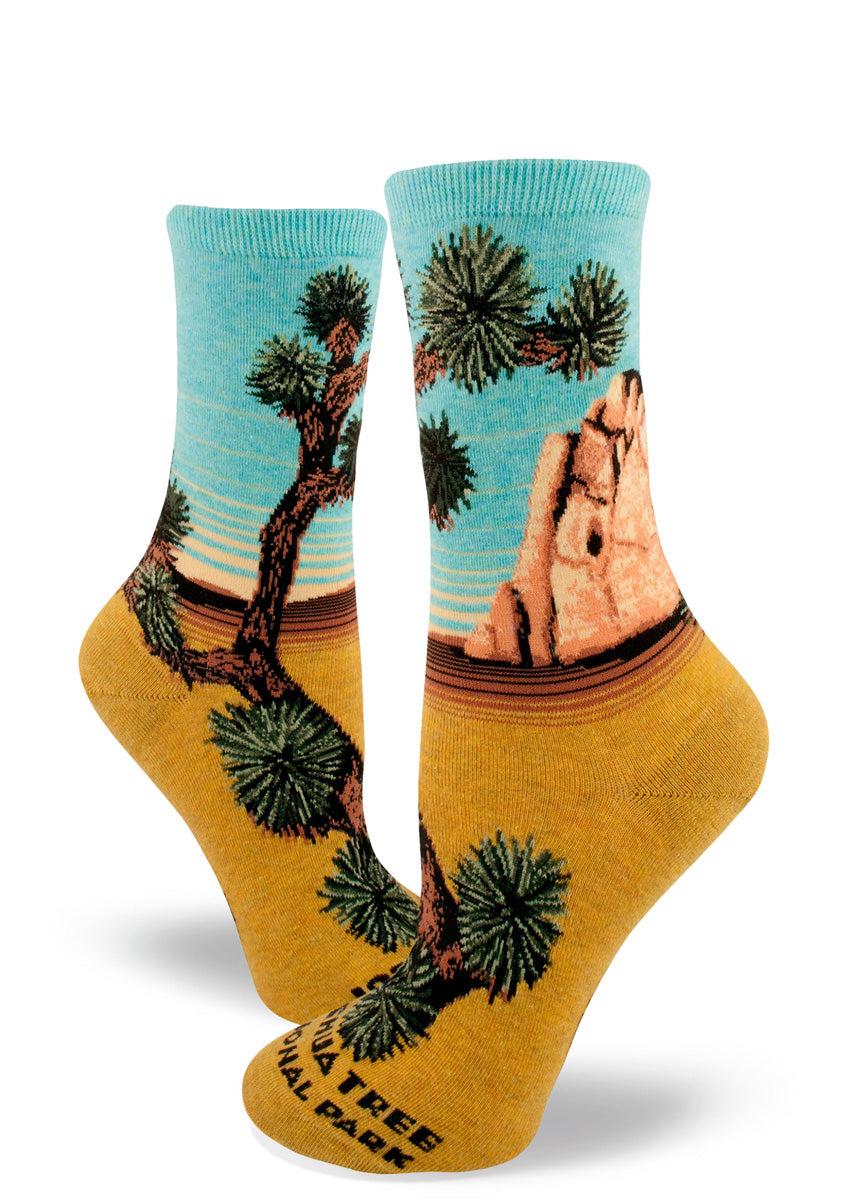 Joshua Tree crew socks for women feature a gorgeous desert scene with golden sand, a rock formation, and yucca trees!
