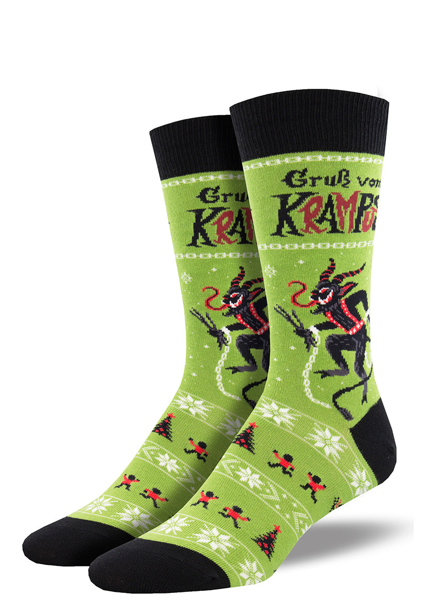 Christmas socks for men show Krampus, the Christmas goat demon, with horns, a long curled tongue, and a trident, ready to chase after naughty children.