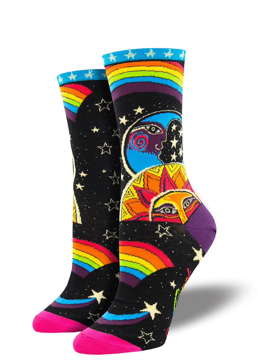 Laurel Burch socks for women feature a colorful cosmic moon and sun, glittering gold stars, and rainbows!