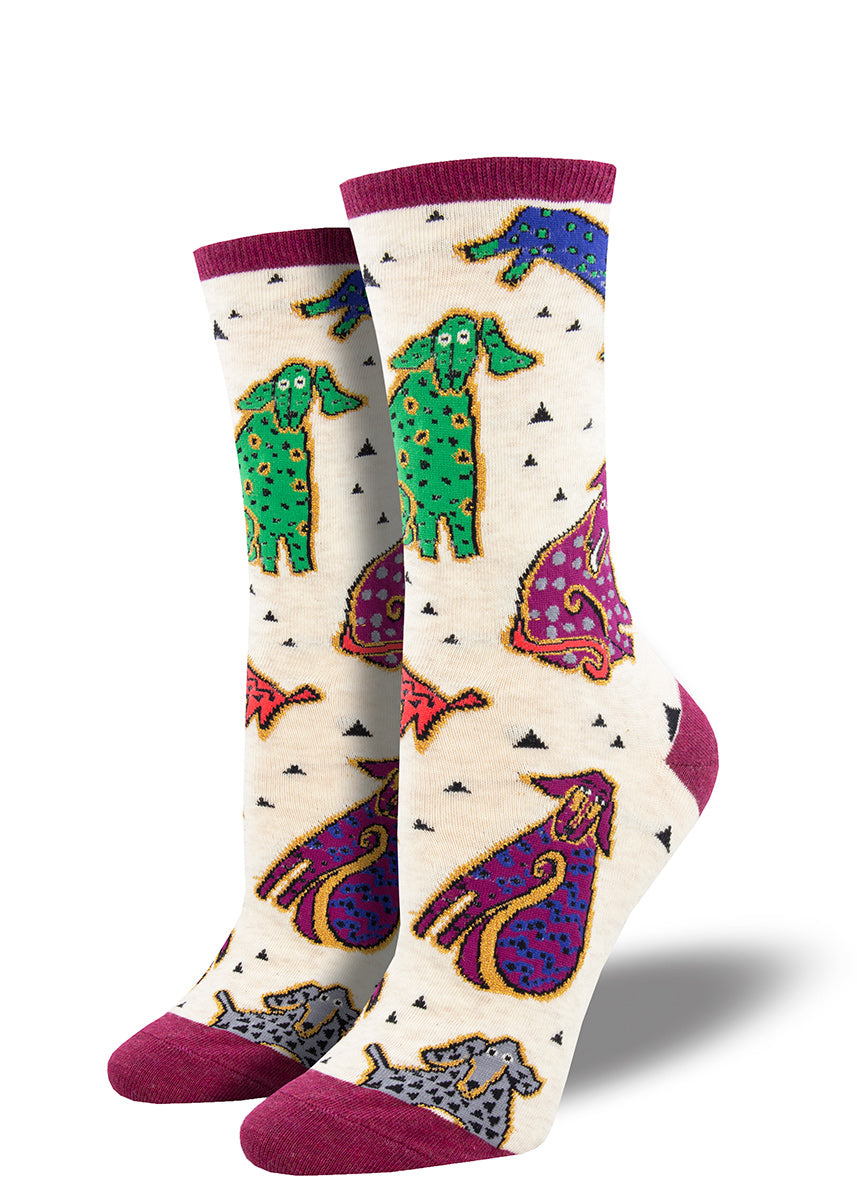 Cute Laurel Burch socks with dogs in bright colors on a cream background