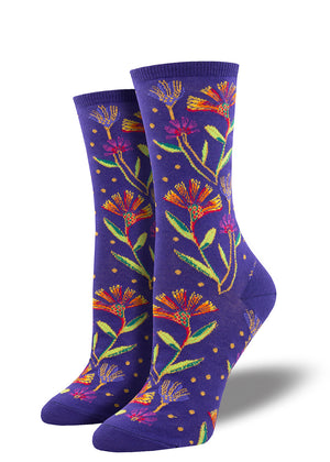 Laurel Burch socks with wildflowers on a purple background