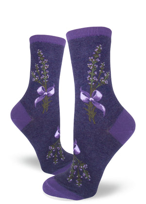 Lavender socks for women with lavender flowers tied in a bunch with purple ribbon on a heather purple background