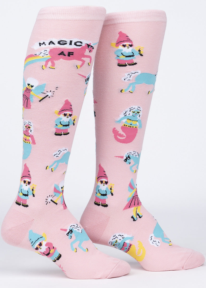 "Fairytale knee socks for women feature gnomes, fairies, mermaids, and unicorns rocking sunglasses with the words, ""MAGIC AF."""