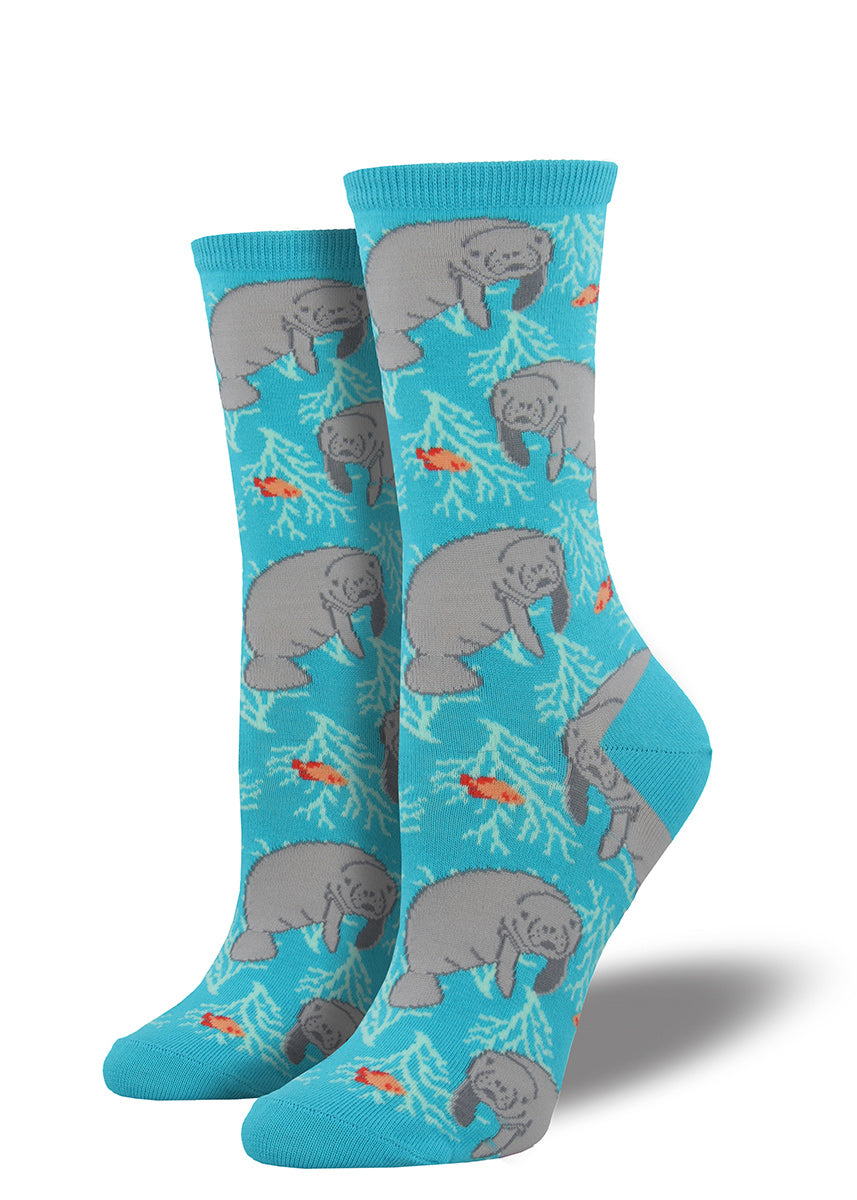 Manatee socks for women with manatees swimming on a blue background