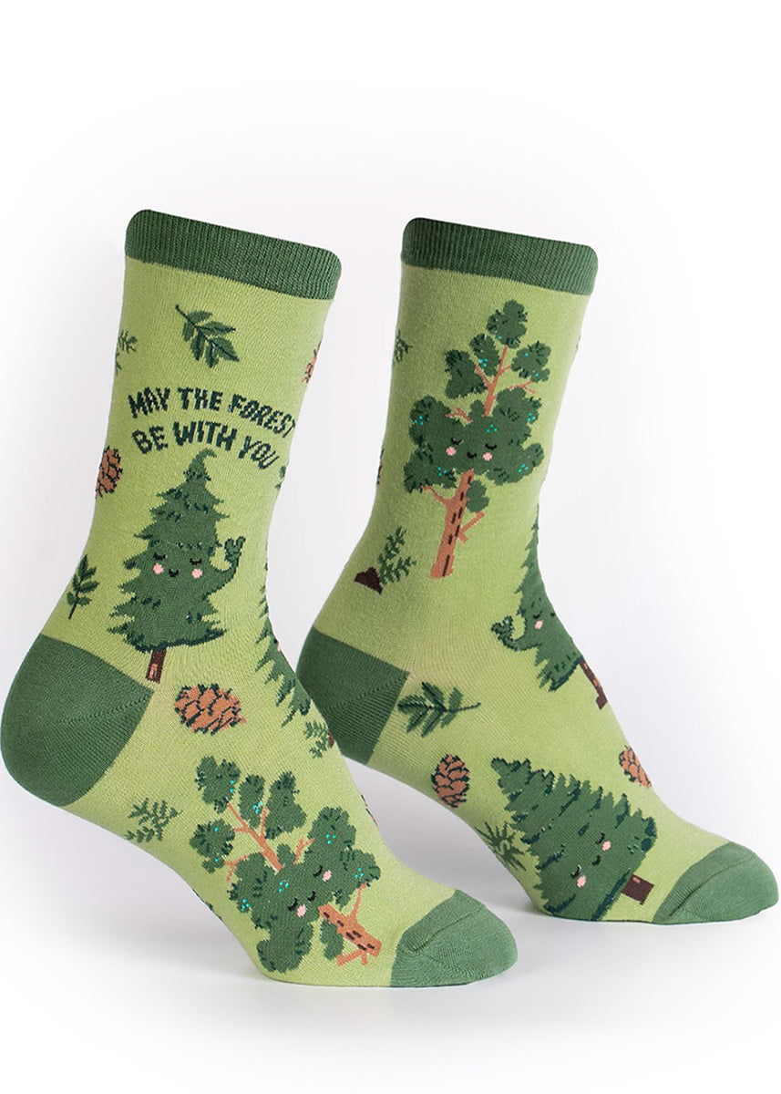 "Green crew socks for women with adorable smiling trees and the words, ""May the forest be with you."""