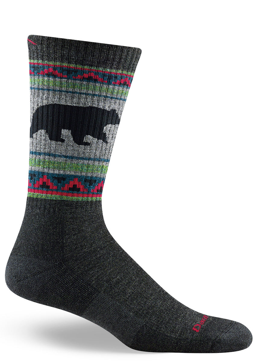 Cushioned wool socks for men come in a long boot-length and feature a silhouette of a bear.