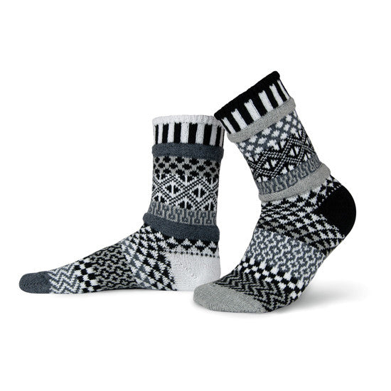 These special mismatched socks are knit with shades of gray, black and white.
