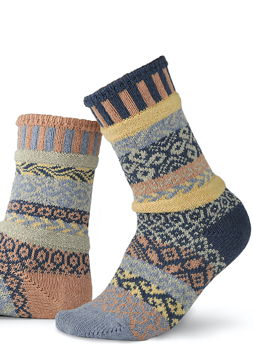 Cozy mismatched pattern socks in peach, pale yellow, dark blue, and light blue.