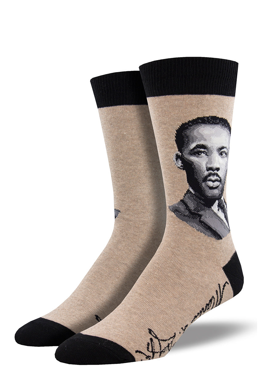 Crew socks for men feature a portrait of civil rights leader Martin Luther King Jr. with his signature on the bottom of the foot.