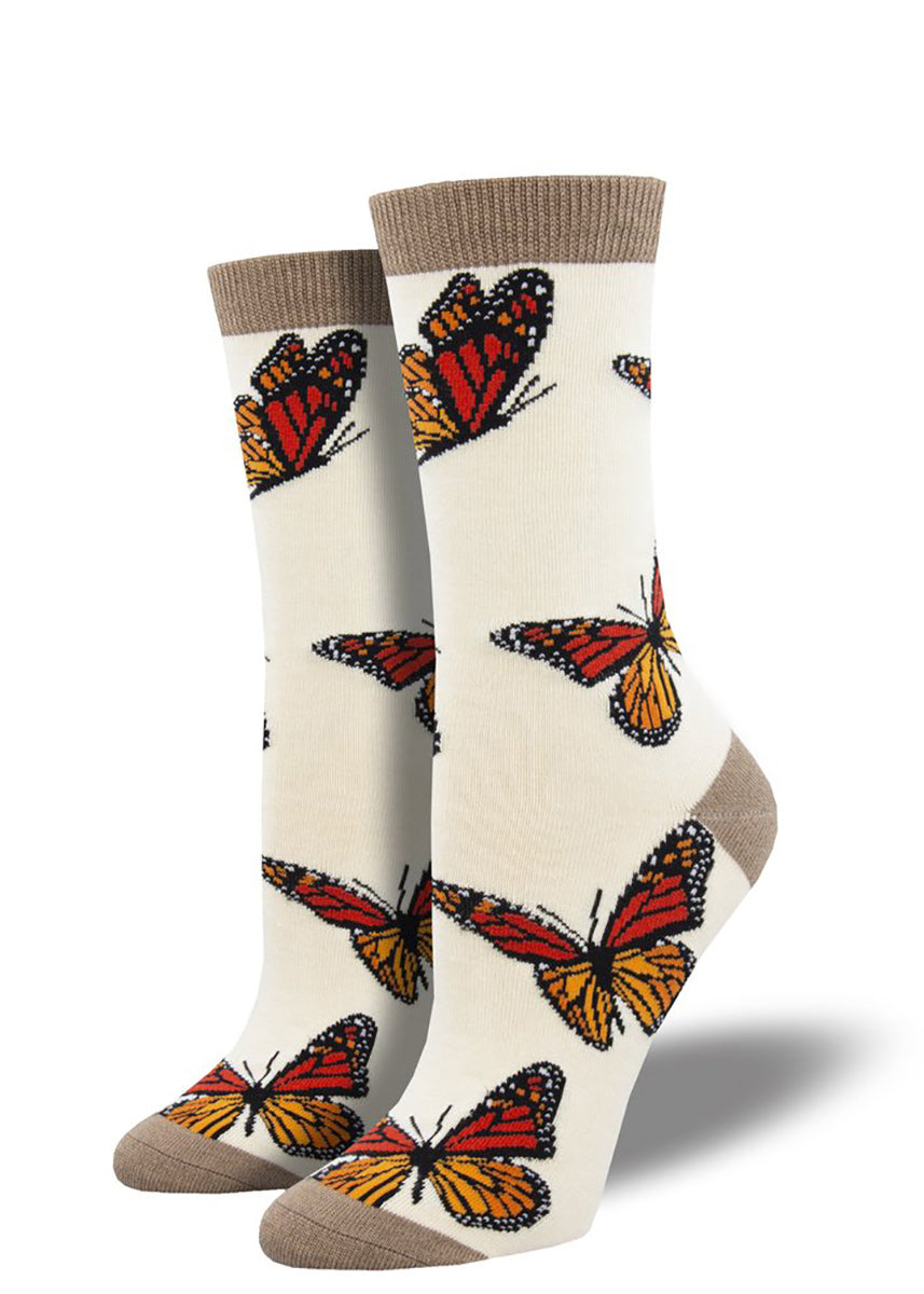 Monarch butterfly bamboo socks on cream background with brown heels, toes and cuffs