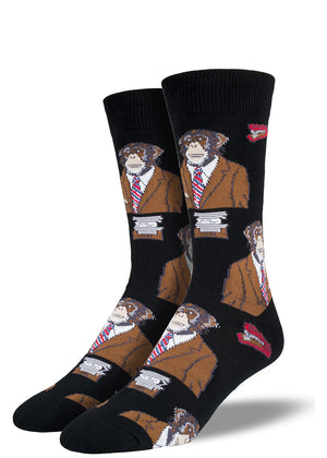 Chimpanzee socks for men with apes wearing suits and red staplers on black men's socks