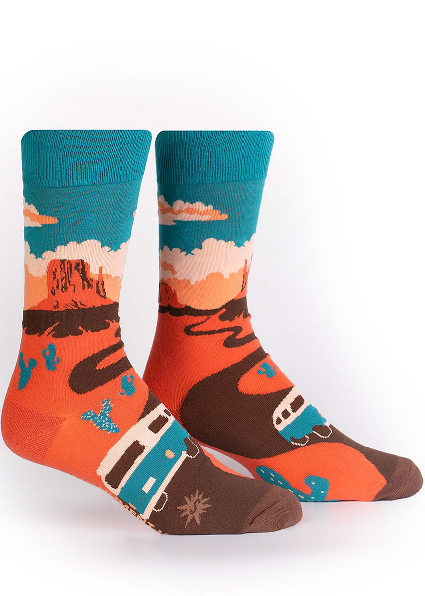 Monument Valley socks for men show a cactus-lined road leading to West Mitten Butte.