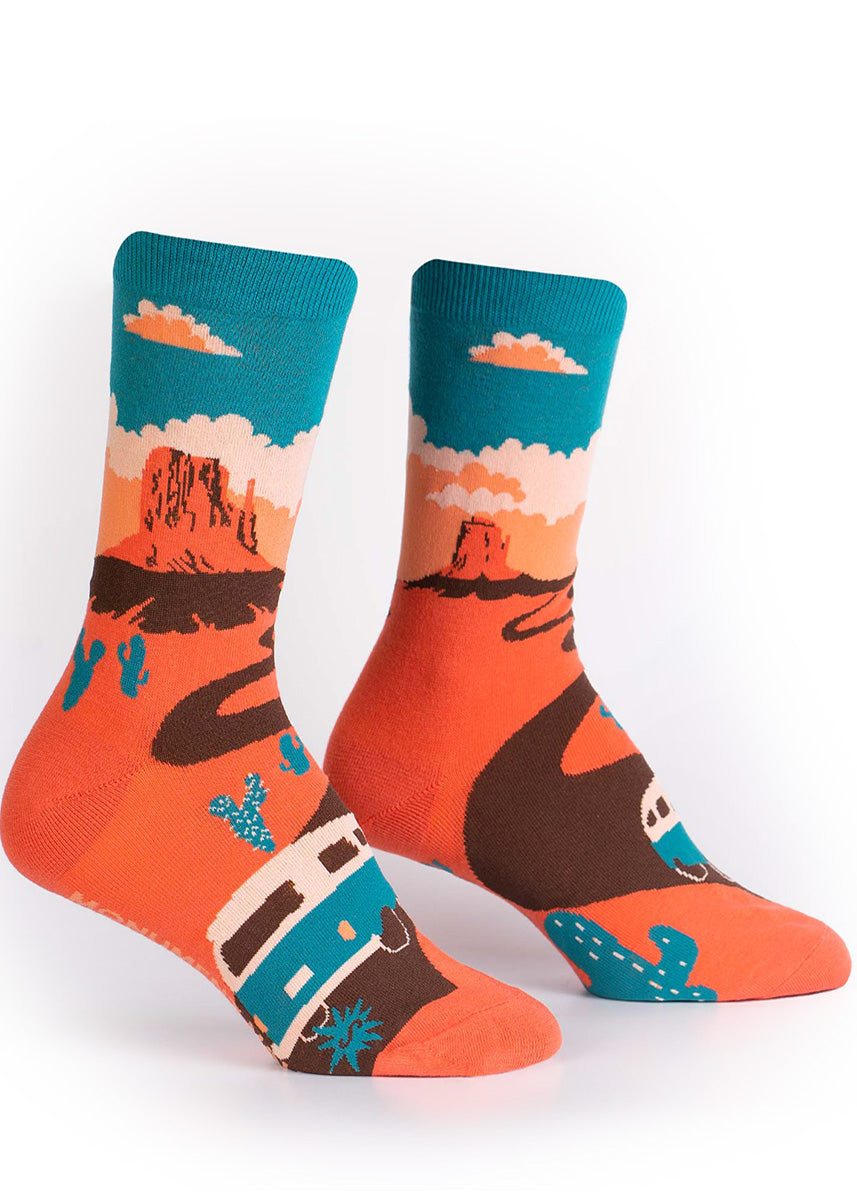 National park socks for women show a van driving through Monument Valley to get to the West Mitten Buttes.