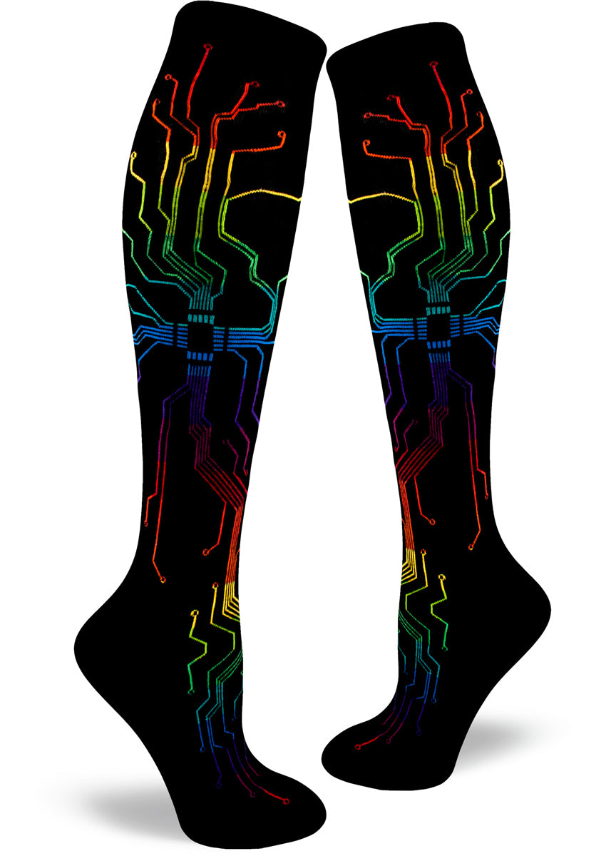 Knee-high circuitboard socks for women with rainbow circuits on a black background