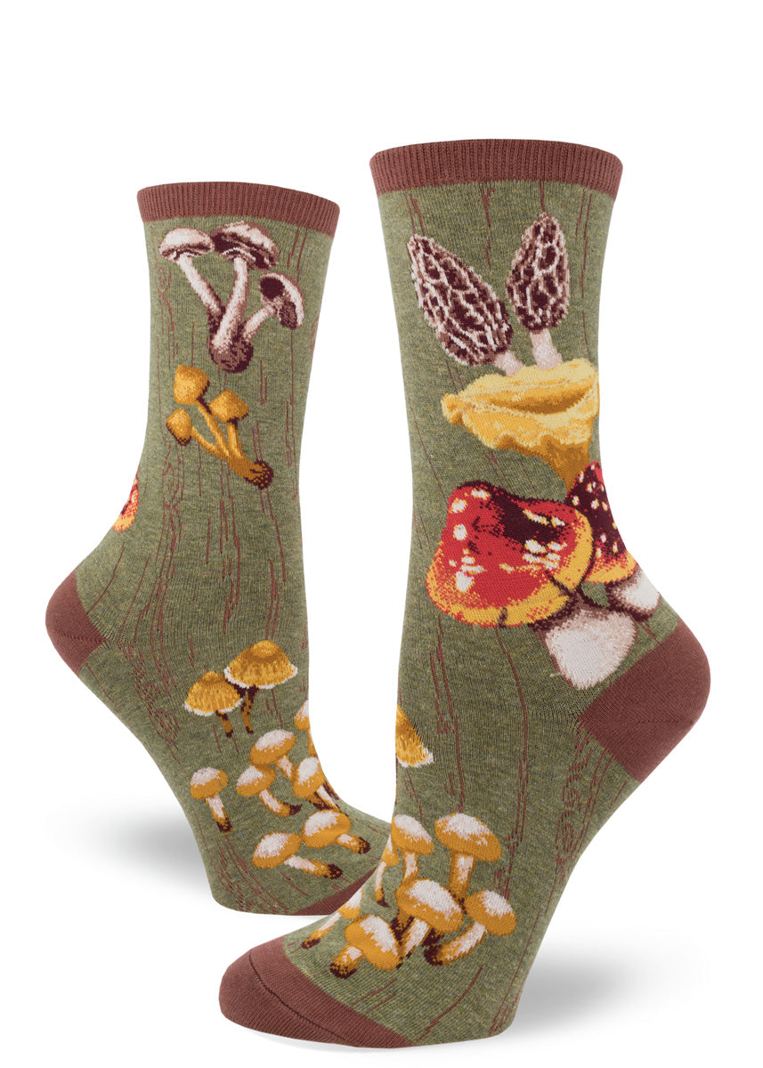 Mushroom socks for women with different mushrooms on a green background