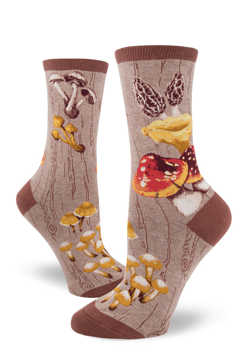 Mushroom socks for women with different mushrooms on a brown background