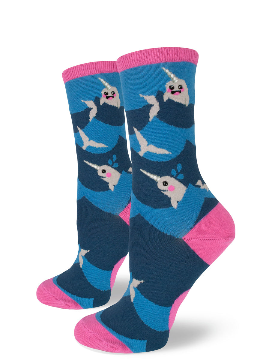 Cute narwhal socks for women with narwhals smiling and swimming between blue waves