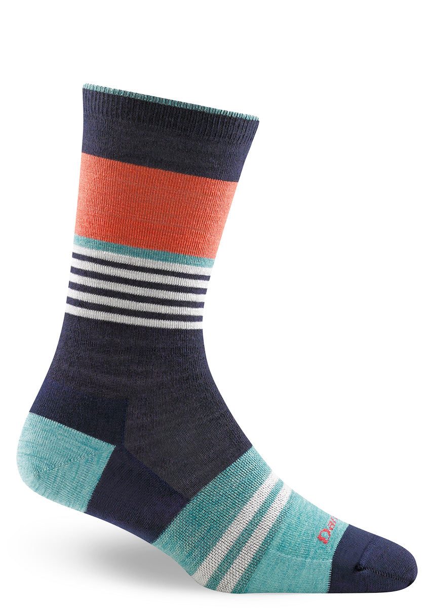 Wool socks for women with white, orange, and light blue stripes on a navy background.