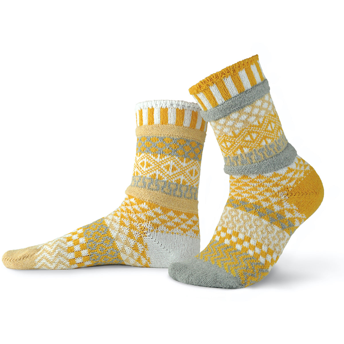 Yellow and gray mismatched socks with a pattern of geometric shapes, stripes and checks.