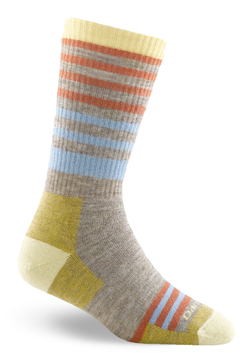 Wool boot socks for women feature orange and light blue stripes on an oatmeal background with yellow cuff, heel, and toe.