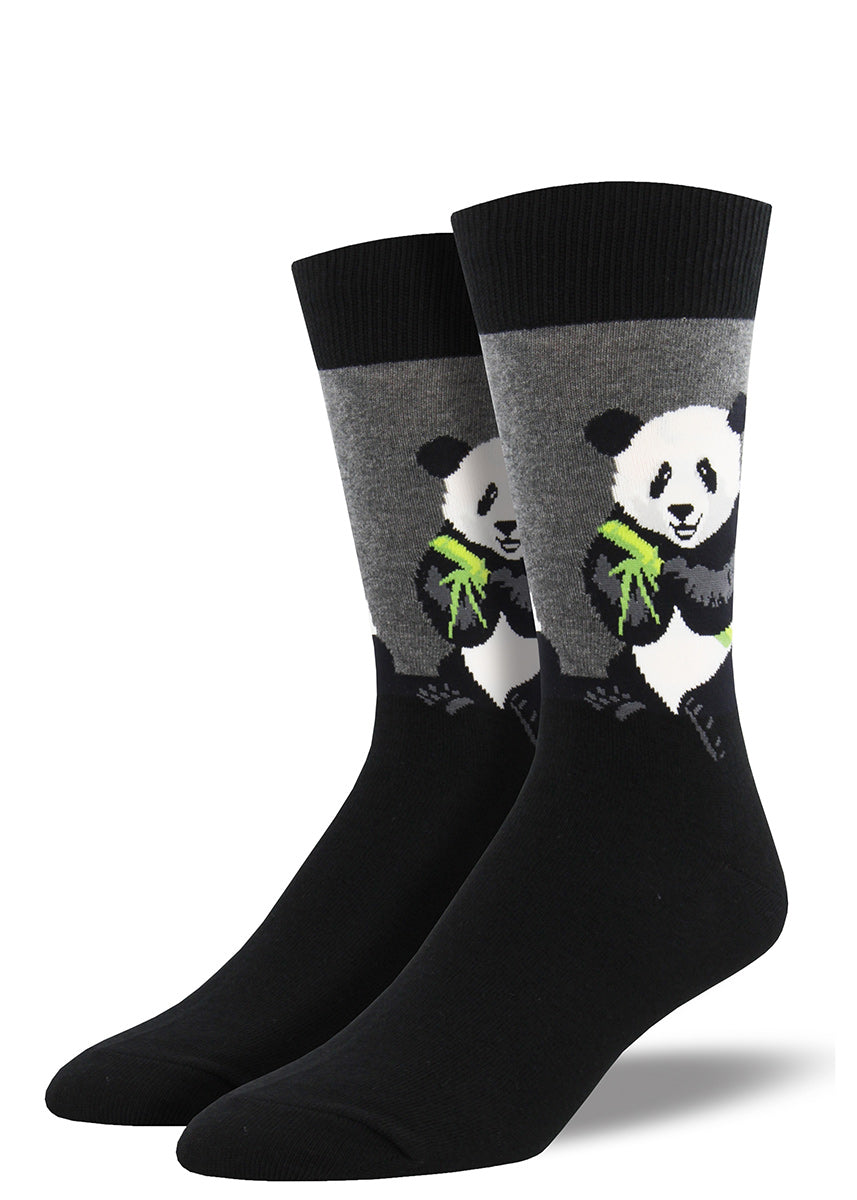 Black and white panda bears munch bamboo against a gray background on these men's socks.