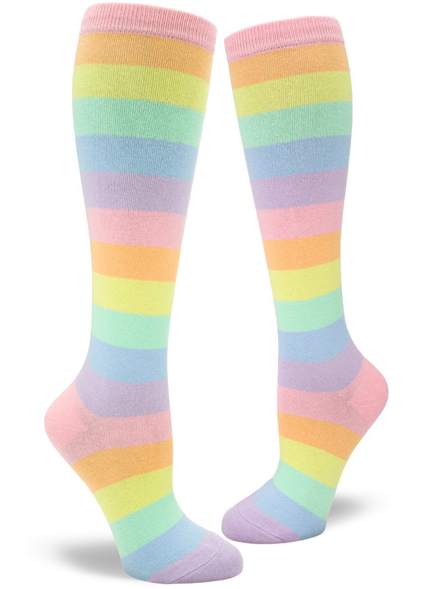Knee high socks for women have pastel rainbow stripes in pale pink, orange, yellow, mint, blue, and purple.