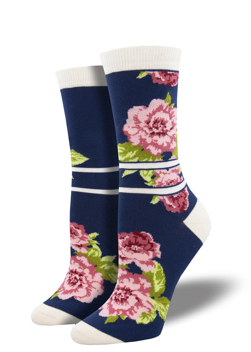 Bamboo crew socks for women feature pink peonies on a navy background with cream stripe accents.