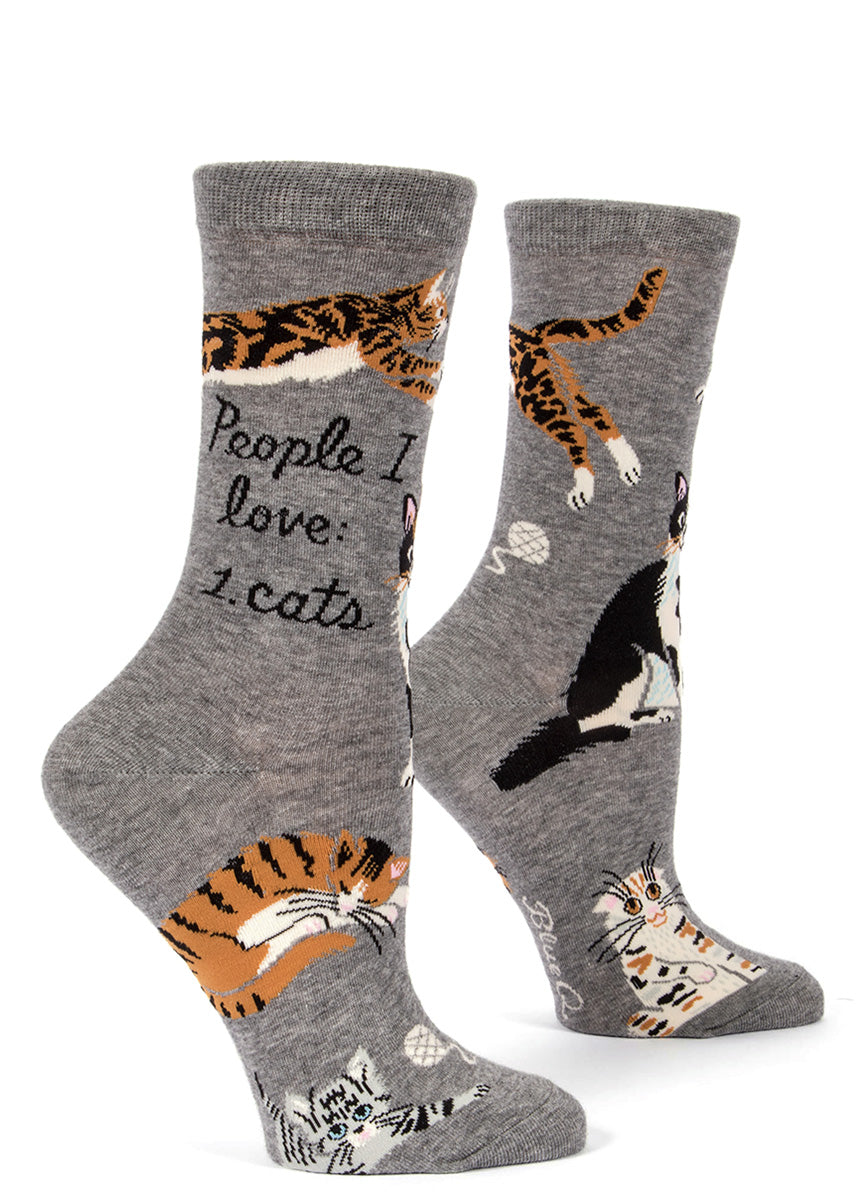 "Women's socks with cats in different colors and the words ""People I love: cats."""