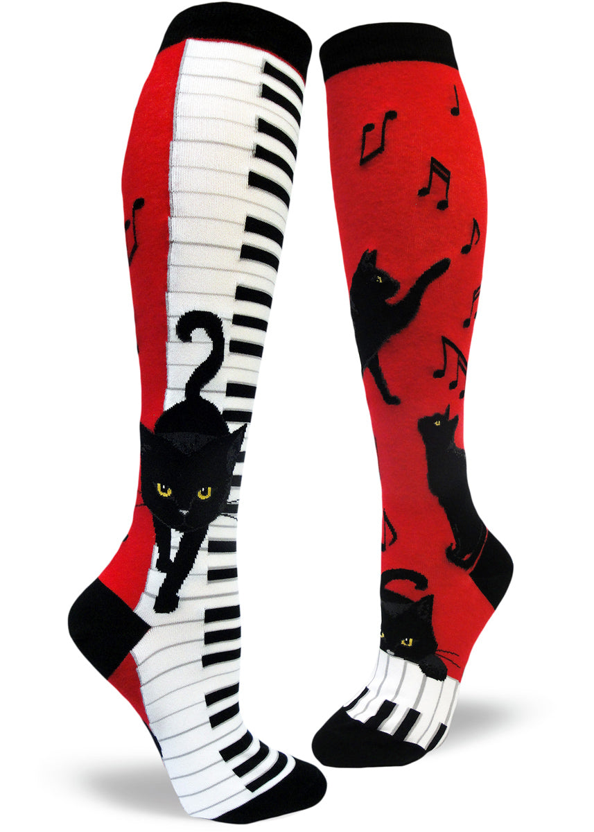Piano cat socks for women with black cats playing piano and music notes on a red background