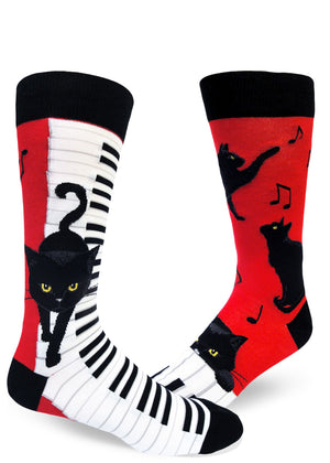 Funny piano cat socks for men with black cats playing pianos and music notes on a red background