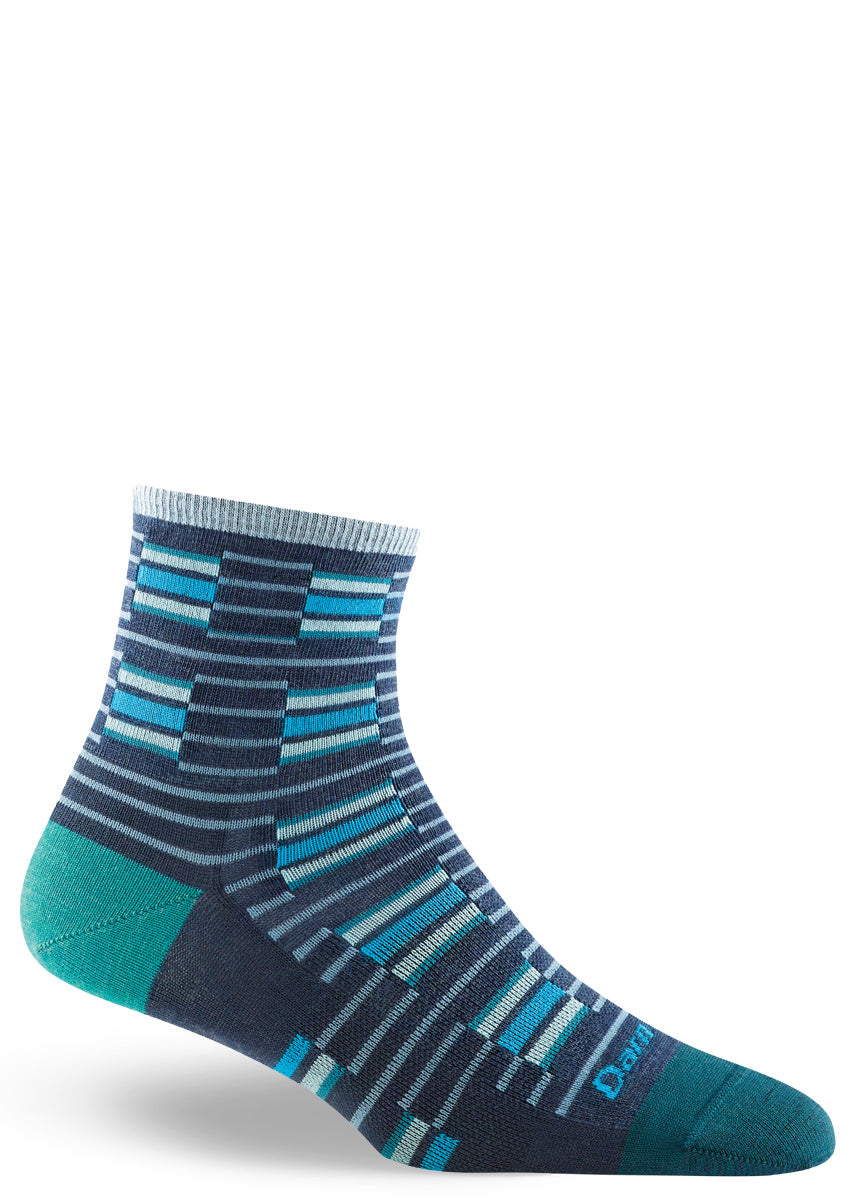 Low-rise wool socks for women feature a funky striped pattern in dark blue and light blue with teal toes and heels.