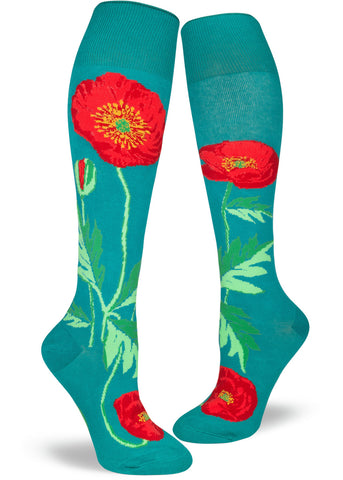 Poppy knee-high socks for women with red poppy flowers on a teal background
