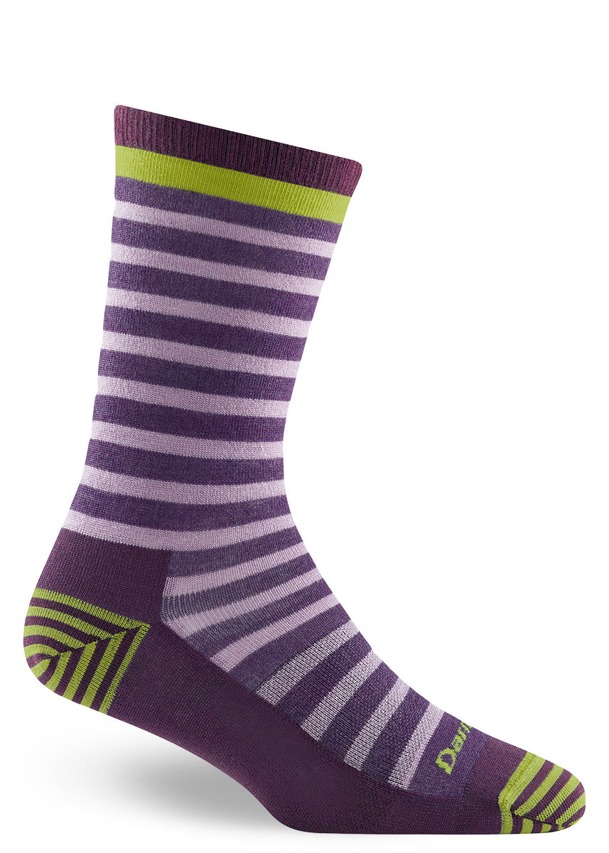 Wool socks for women feature light purple stripes on a dark purple background with lime green accents.