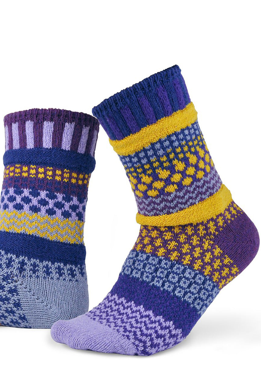 Mismatched socks feature funky patterns in bands of purples and yellows!