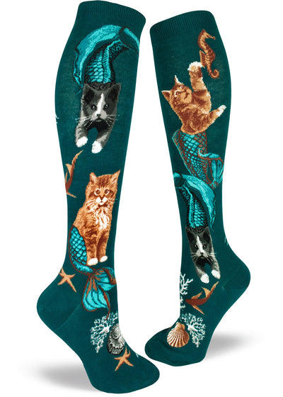 Knee-high purrmaid socks for women with cat mermaids swimming under the ocean on a deep teal background