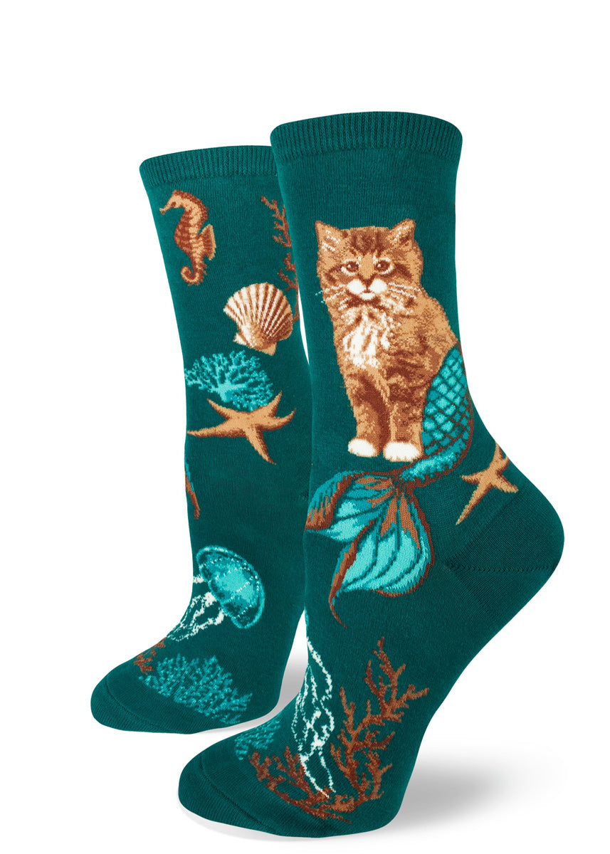 Purrmaid socks for women with cat mermaids and seashells on a teal background
