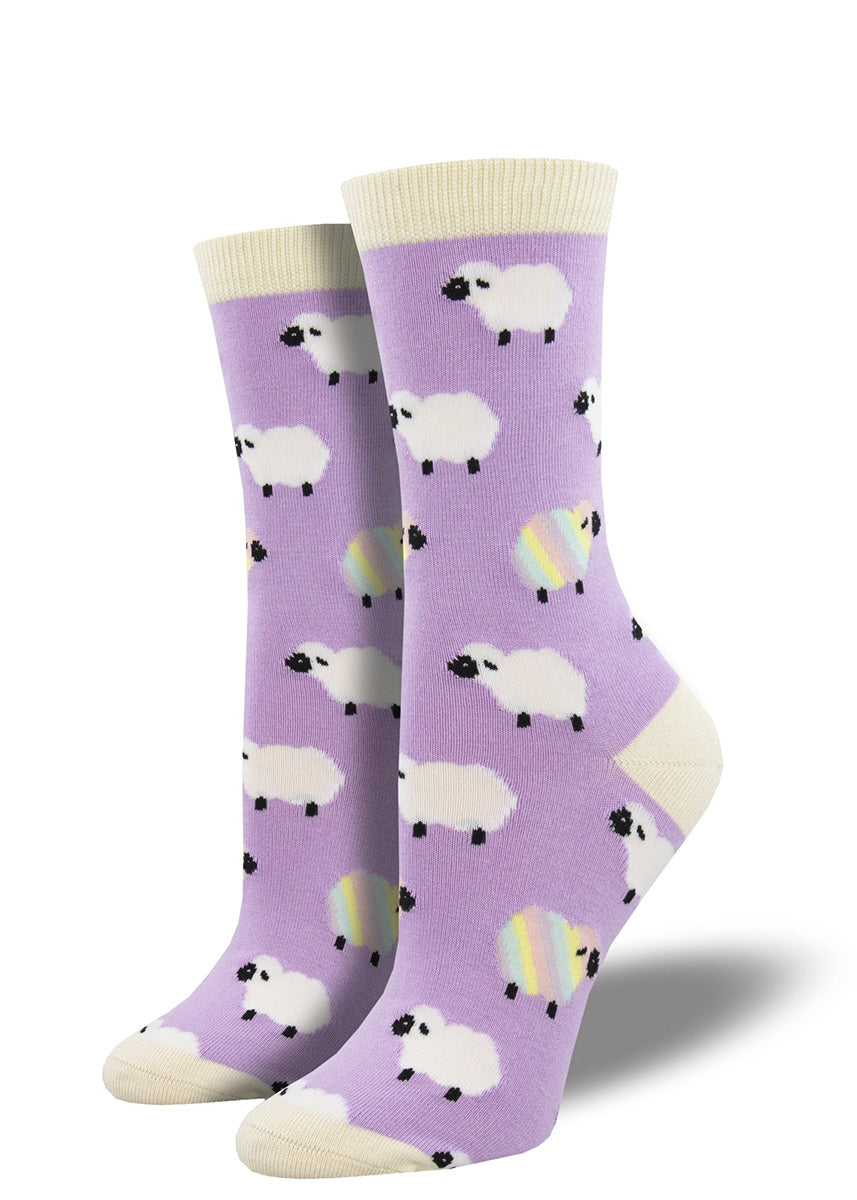 Bamboo crew socks for women feature adorable white and pastel rainbow sheep on a lavender background!