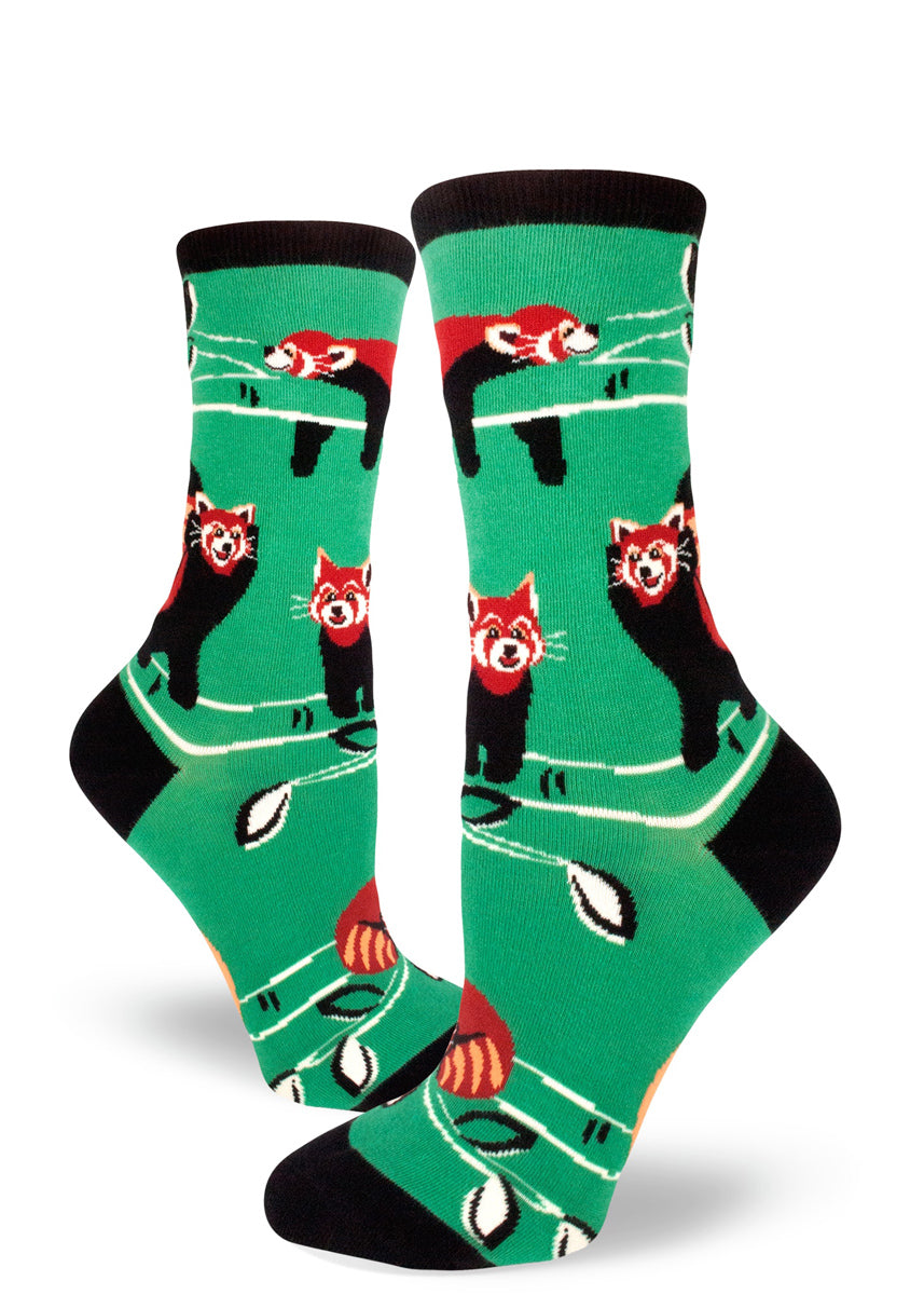 Cute red panda socks for women with red pandas playing and sleeping on a mint green background