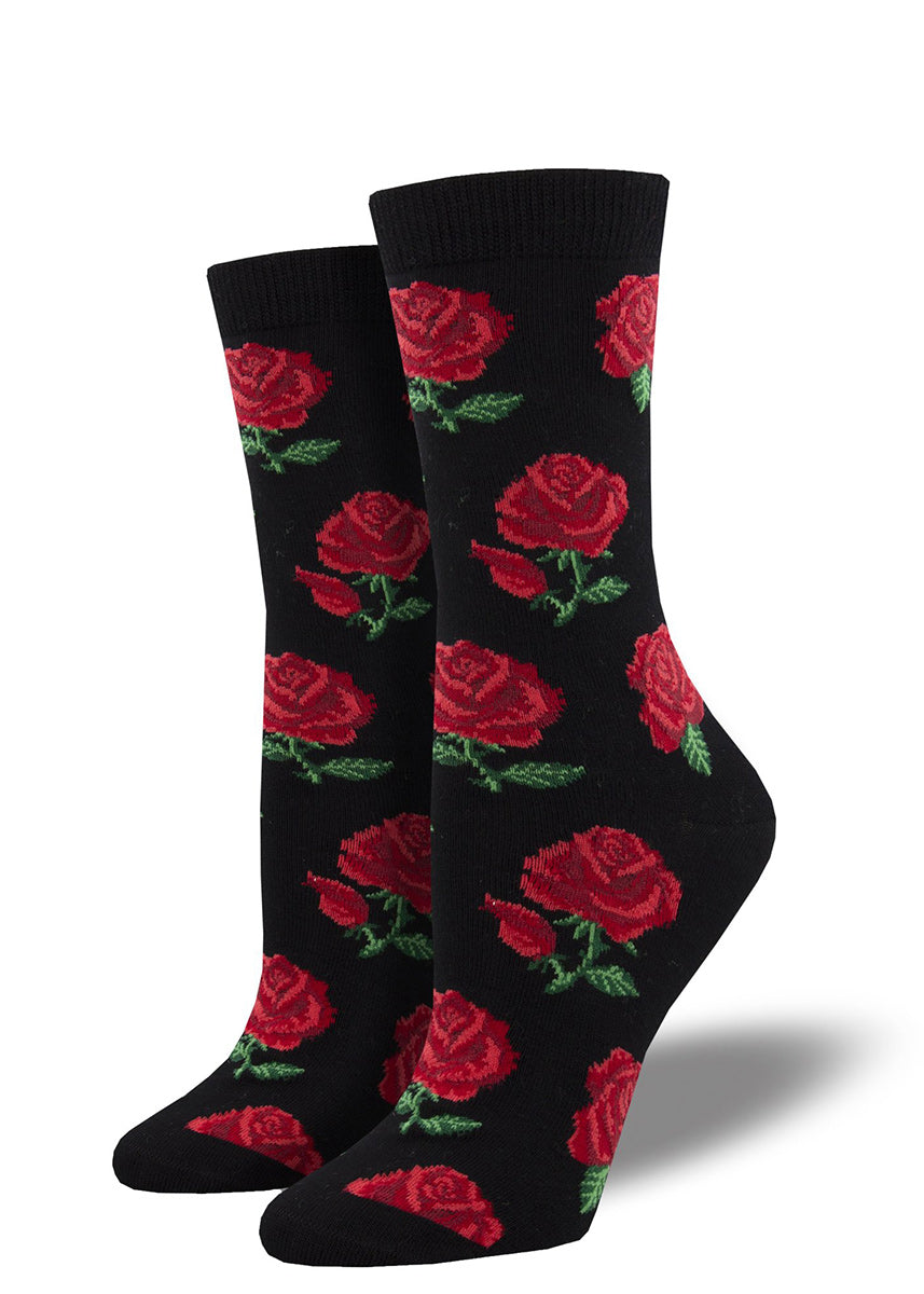 Crew socks for women are made of super-soft bamboo and feature a design of realistic red roses on a black background.