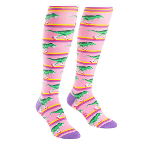 Knee-high rollerskating T-rex dinosaur socks for women.