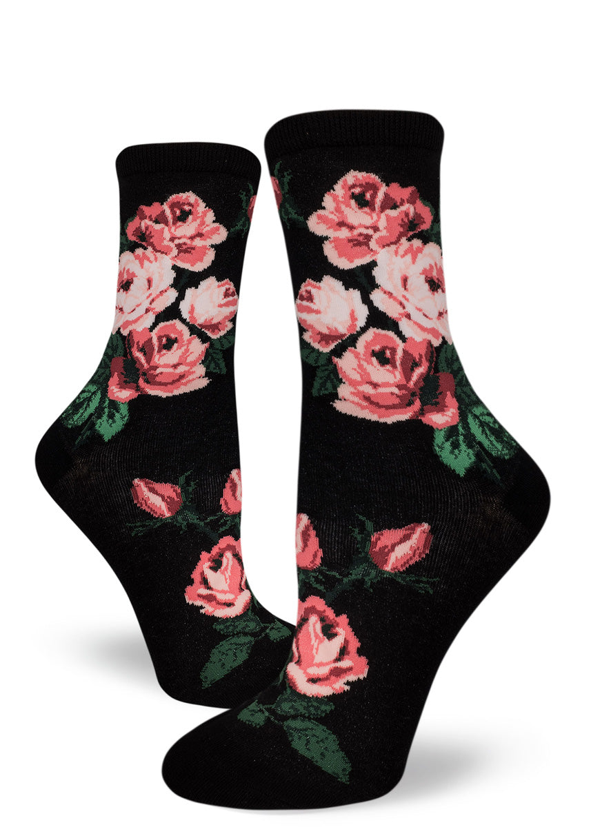 Rose socks for women with pink roses on a black background.