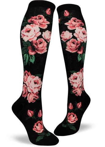 Rose knee socks for women with pink roses on a black background