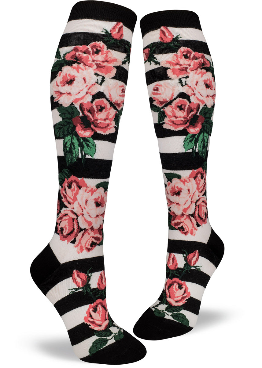 Rose socks for women with pretty pink roses on a black & white striped background.